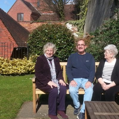 Residents enjoying the gardens with one of the trustees