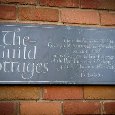 Plaque on the Guild Cottages