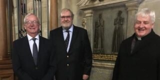Clive Mason, chairman of Thomas Oken Charity with fellow trustee Terry Brown and the Rev Vaughan Roberts beside the Thomas Oken memorial plaque at St Mary's Church in Warwick